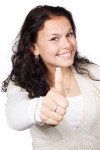 girl doing thumbs up