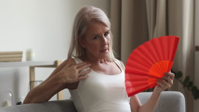 woman with a red fan