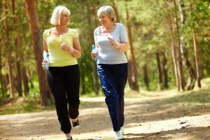 Two-older-women-jogging-exercising
